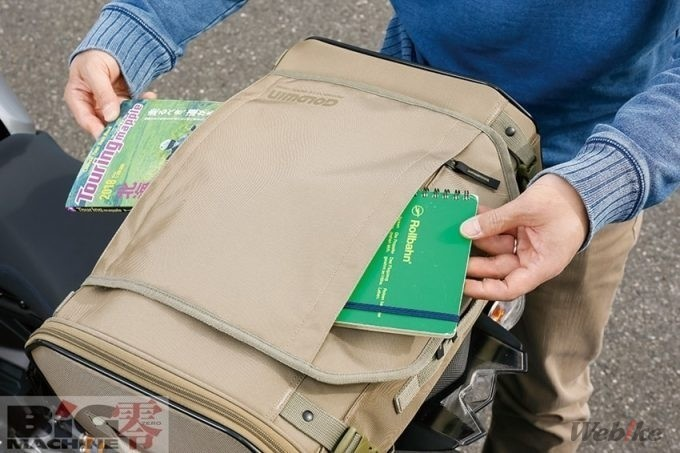 ▲ Bagian atasnya dilengkapi kantung dengan ritsleting yang berguna untuk menyimpan barang berukuran kecil di kedua sisi.
